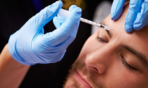 Man getting a botox injection