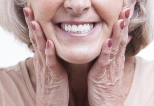 Both dental implants and dentures offer unique advantages. Learn what option is right for you from your trusted dentist in Tulsa, Dr. Angie Nauman.