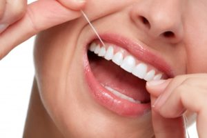 Woman flossing