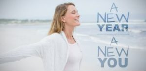 "Smiling woman with sign that reads, ""New Year, New You"""