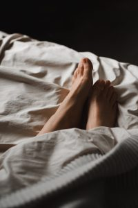 Woman's feet in bed at a sleep test in Tulsa