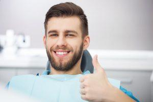 Man gives his Tulsa sedation dentist a thumbs up