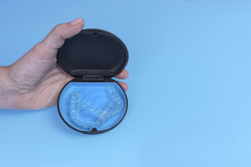 Invisalign in case on blue background